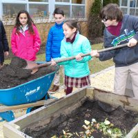 St Leo - Students add food scraps to the school compost